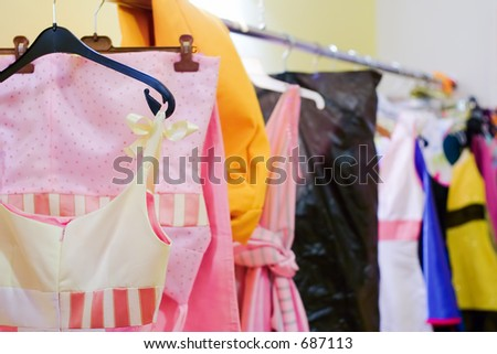 Designer clothes lined up in a closet - stock photo