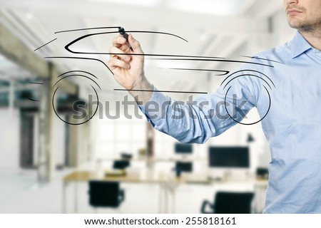 designer draw sketch with new concept car - stock photo