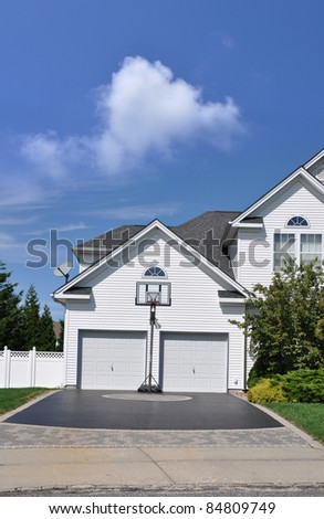 Designer Driveway Basketball Hoop Suburban Home Sunny Day