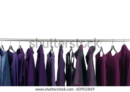 Designer fashion clothing on hangers at the show - stock photo