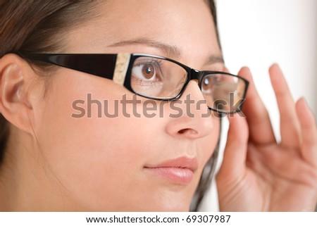 Designer glasses - portrait of trendy woman fashion - stock photo