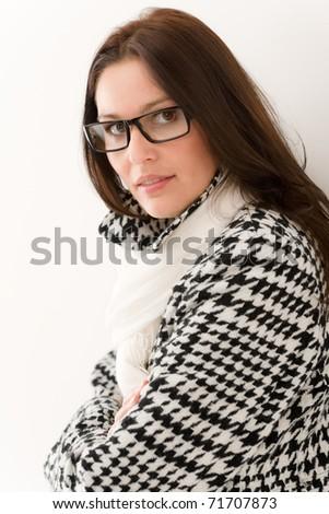 Designer glasses - winter fashion woman portrait wear coat and scarf - stock photo