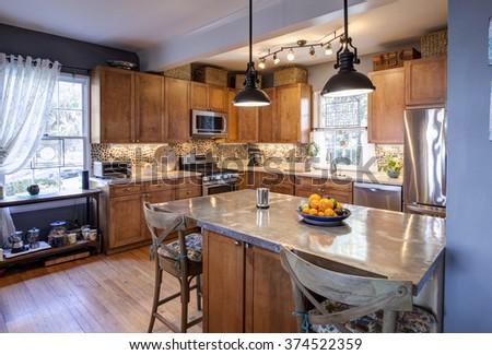 Designer kitchen remodel in eclectic style with stainless steel and stone - stock photo