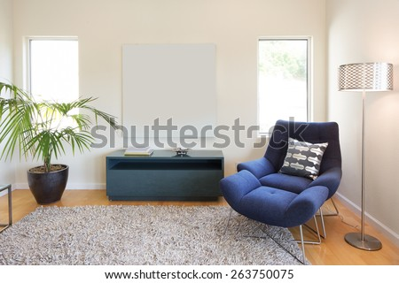 Designer launching chair with pillow and lamp. Living room interior with copy space for art or poster with hand-woven natural colored fine sisal rug open space living room within nature. - stock photo