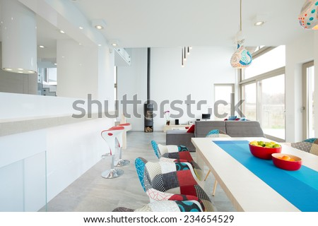 Designer patterned chairs in contemporary dining room - stock photo