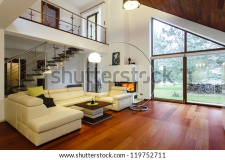 Designer's house with entresol and spacious living room - stock photo