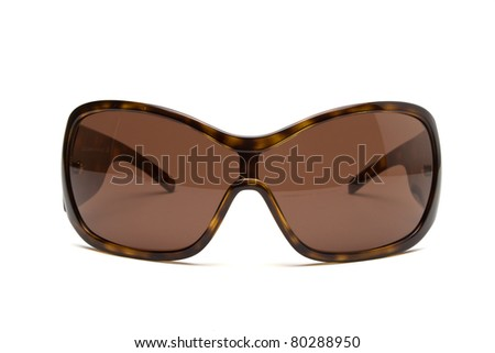 Designer Sunglasses in brown isolated on white from low perspective. - stock photo