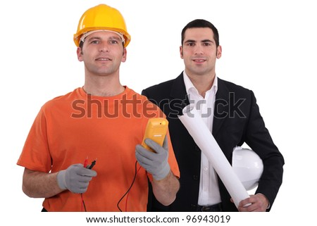 Designer with electrician - stock photo