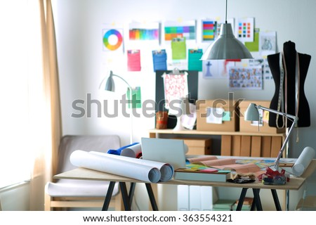 Designer work place with sew manikins, in office - stock photo