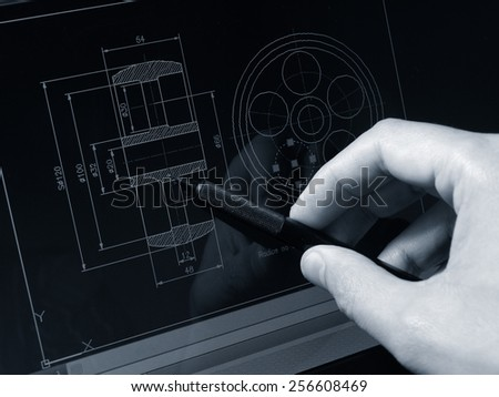 designer working on a cad blueprint  - stock photo