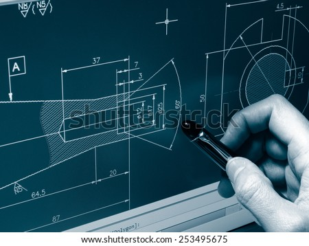 designer working on a cad blueprint monochrome image - stock photo