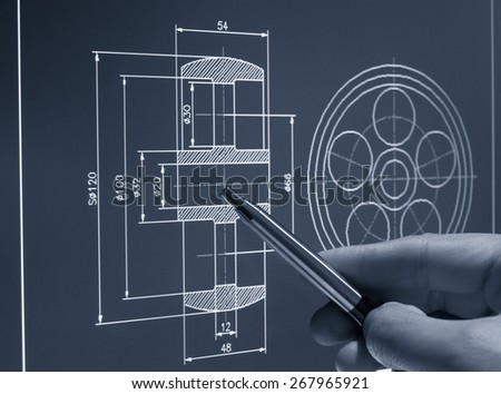 designer working on a cad blueprint monochrome image - stock photo