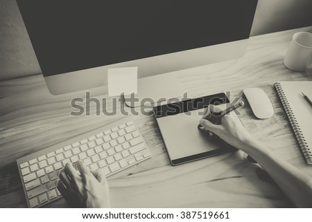 Designer working using computer black and white color
