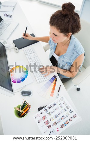 Designer working with colour wheel and digitizer in the office - stock photo