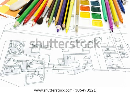 designers desk with drawing tools and a living room sketch - stock photo