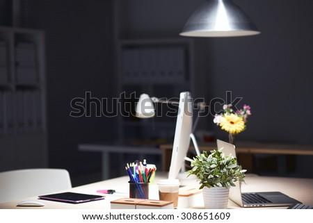 Designers desk with laptop - stock photo