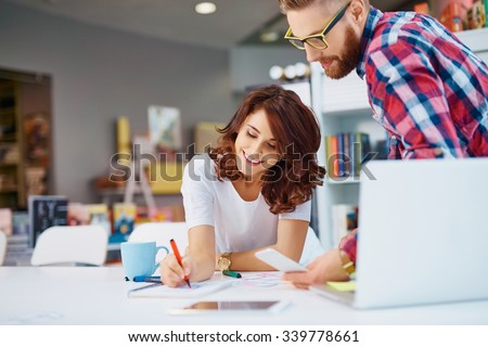 Designers working on new project in modern office - stock photo