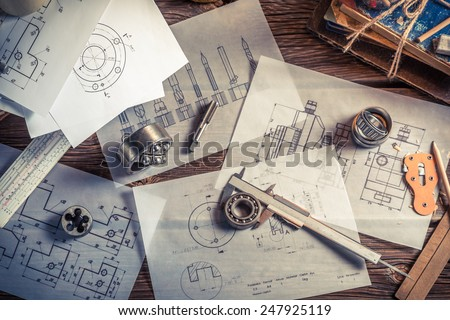 Designing mechanical parts by engineer - stock photo