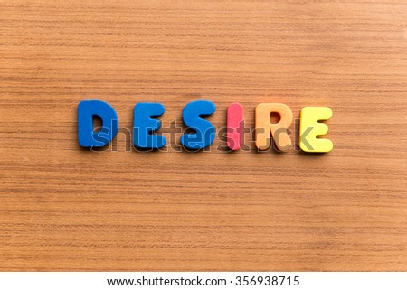 desire colorful word on the wooden background - stock photo