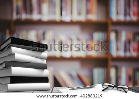 Desk against library shelf - stock photo