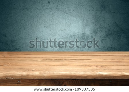 desk and blue wall  - stock photo