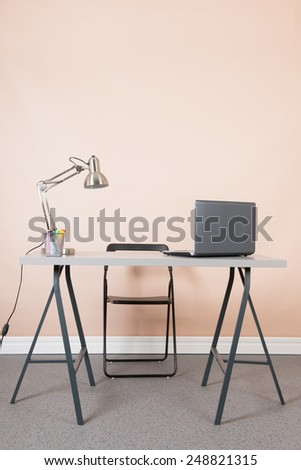Desk and chair in an empty office - stock photo