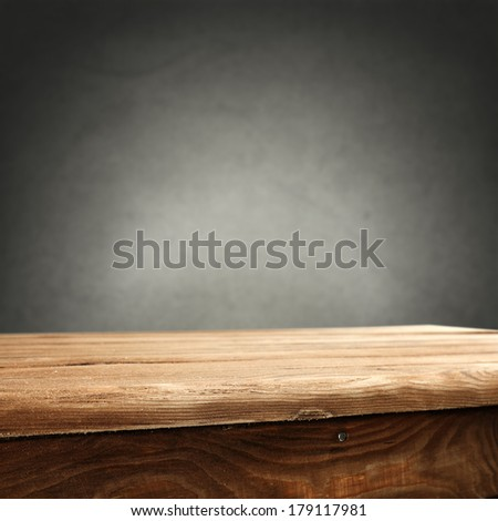 desk and gray wall  - stock photo