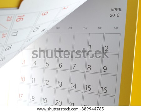 desk calendar with days and dates in April 2016, flip the calendar page - stock photo