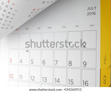 desk calendar with days and dates in July 2016, acronym letters US in the fourth of July, the symbol of American Independence Day, flip the calendar page - stock photo