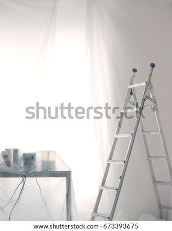 desk covered in transparent dust sheets in preparation for decoration