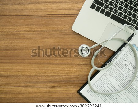 desk' doctor with computer, stethoscope, medical record application form. top view - stock photo