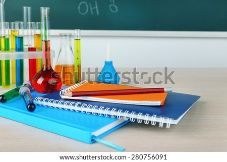 Desk in chemistry class with test tubes close up - stock photo
