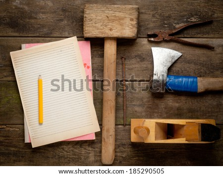 Desk of a carpenter with some tools - stock photo