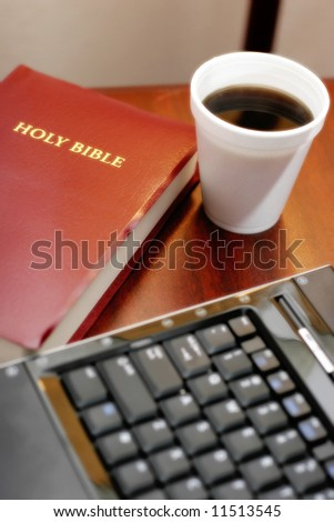 Desk of Businessperson of Faith or Pastor's Desk – can represent tradition and technology, modern Bible study, faith in modern culture, etc. (shallow focus on Bible & coffee, slight glow effect). - stock photo