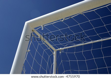 Desk of football with blue background sky - stock photo