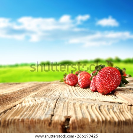 desk of fruits and landscape  - stock photo
