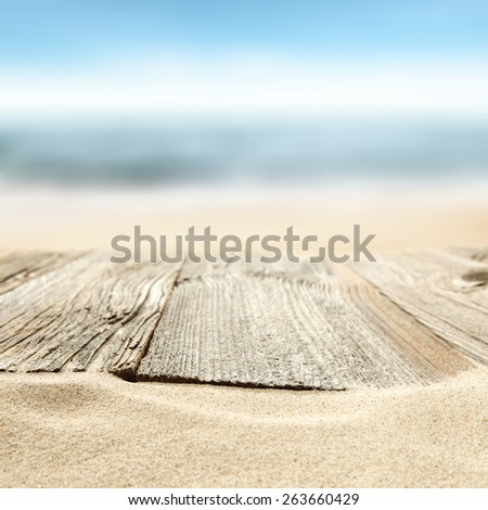desk of gray color in sand and sea  - stock photo