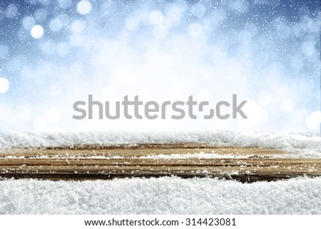 desk of wood and snow  - stock photo