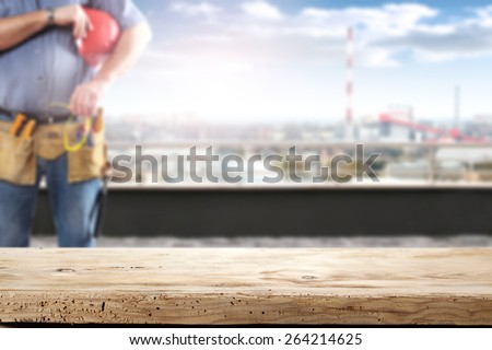 desk of wood and terrace with worker  - stock photo