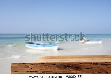 desk of wood and white and blue ship  - stock photo