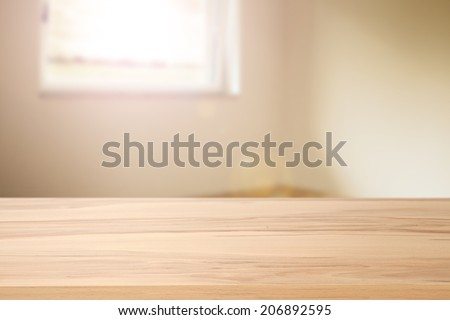 desk of wood and window space with sun  - stock photo