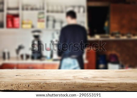 desk of wood cafe interior and man  - stock photo