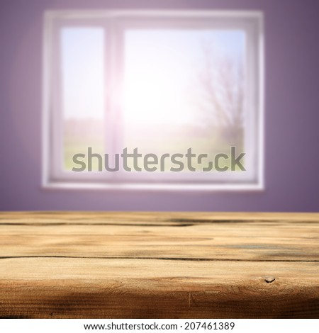 desk of wood in yellow color and window  - stock photo