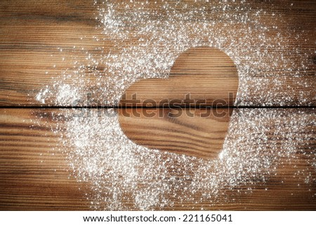 desk of wood with mark of heart in flour  - stock photo