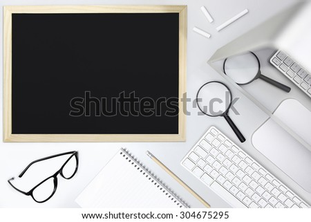 desk school concept, blackboard, magnifying and computer, top view - stock photo