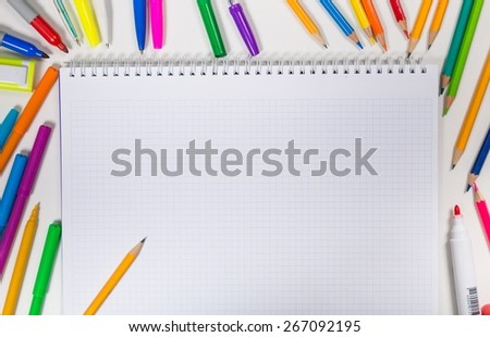 Desk. School stationery isolated over white with copyspace - stock photo