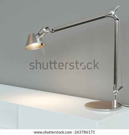 Desk steel lamp on white table over grey background. Conceptual picture - stock photo