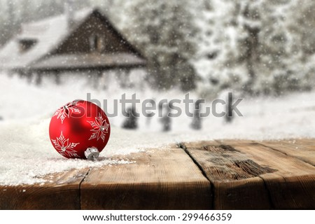 desk top and shiny snow with red ball  - stock photo