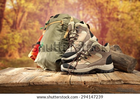 desk top backpack shoes and travel time  - stock photo