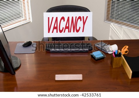 Desk with a Vacancy sign.  Your text in the blank name plate.  Great for employment/HR/unemployment themes. - stock photo